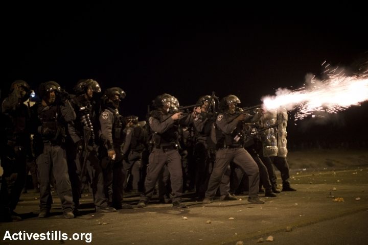 Police shots tear gas at protestors at head level during Day of Rage protest against the Prawer-Begin Plan, near the twon of Hura, Israel, November 30, 2013. (+972 Magazine)