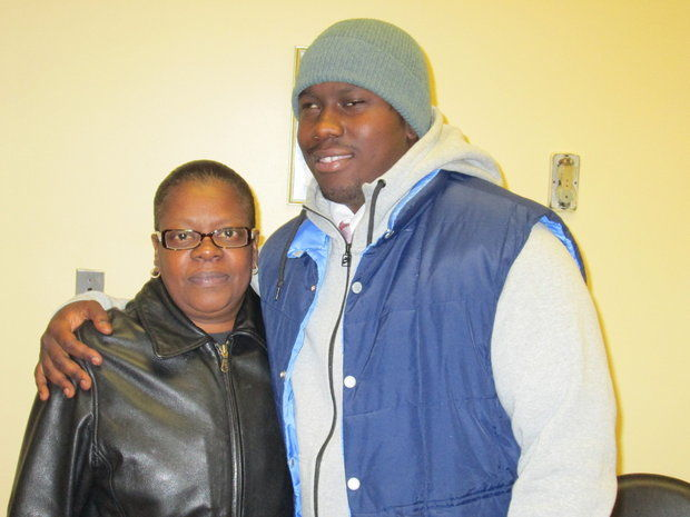 Kwadir Felton, 22, of Jersey City, and his mother, Dawn Felton, stand outside the courtroom of Felton's trial on Wednesday, Nov. 13, 2013. (Jonathan Lin/The Jersey Journal)