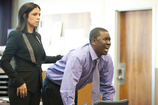 Kwadir Felton, with his attorney Brooke Barnett, reacts to verdict handed down by jury on Thursday, Nov. 14, 2013 in Jersey City. Felton was found guilty of aggravated assault and other offenses after being shot by Sgt. Thomas McVicar on Jan. 10, 2010. (Reena Rose Sibayan/The Jersey Journal)